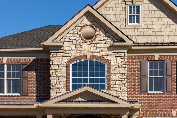 Brick & Stone Home with Battle Creek (Engineer) & Southern Malt Cut Cobble