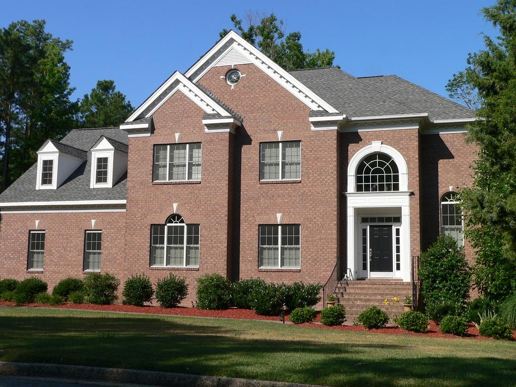 Brick Home With Ashcroft Rose