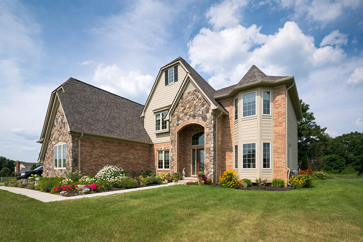 Brick & Stone Home with Illini Commons & Buckingham Fieldstone