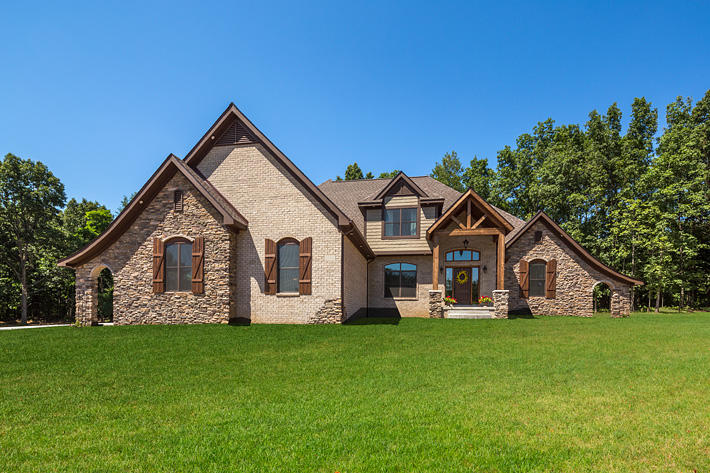 Brick & Stone Home with Anchor Bay & Buckingham Ledgestone