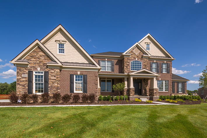Brick & Stone Home with Battle Creek & Buckingham Ledgestone