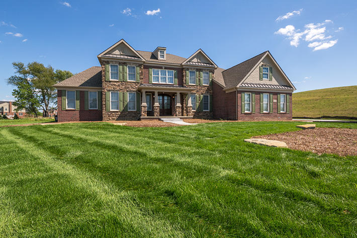 Brick & Stone Home with Ellsworth & Buckingham Ledgestone