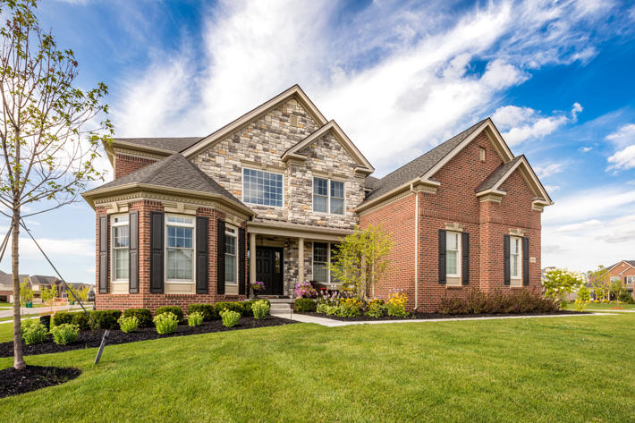 Brick & Stone Home with Ellsworth & Kentucky Gray Limestone